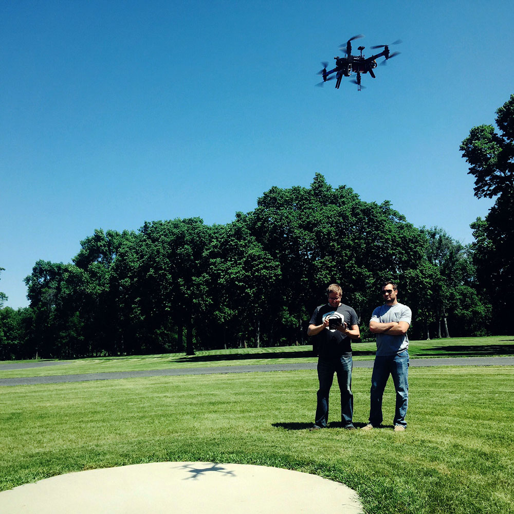 Co-founders Alex Kube and Shawn Muehler flying a multirotor (3DR X8) with the Botlink platform in Fargo, North Dakota